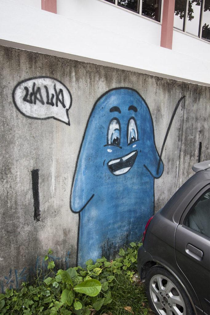 Fischender Geist als Streetart in Georgetown